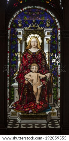 Rome, Italy - May 2, 2014: Madonna Enthroned is a Neo-Gothic stained glass made by Italian artist Giuseppe Bertini (1825-98). Library of Vatican Museums - stock photo