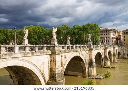 ROME, ITALY - MAY 03, 2014: People on the bridge of Castel Sant'Angelo in Rome, Italy - stock photo