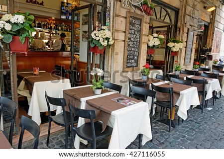 Rome, Italy - May, 16.2016 - Tables and chairs of a restaurant near Piazza Navona