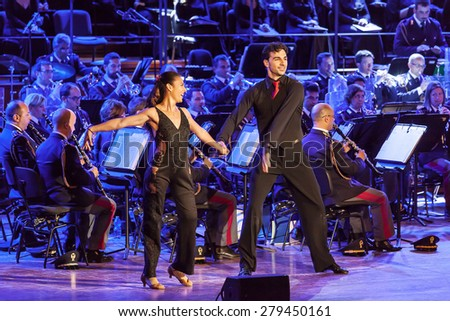 Rome, Italy - May 6, 2015: The dancers Giusy Versace and Raimondo Todaro, dance accompanied by the music of the Band of the State Police. - stock photo