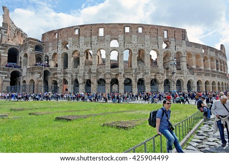 Rome, Italy - May, 15.2016 -  the Flavian Amphitheatre, aka Colosseum, iconic symbol of Imperial Rome, as seen on May 15, 2016. - stock photo
