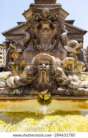 ROME ITALY - MAY 26 2014:The Pantheon and the Fontana del Pantheon. Northwest side view. The Pantheon's dome is still the world's largest unreinforced concrete dome. Piazza della Rotonda, Rome, Italy. - stock photo