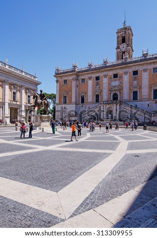 ROME, ITALY - May 10, 2015 : Tourists visit Piazza del Campidoglio, famous square in central Rome designed by Michelangelo - stock photo