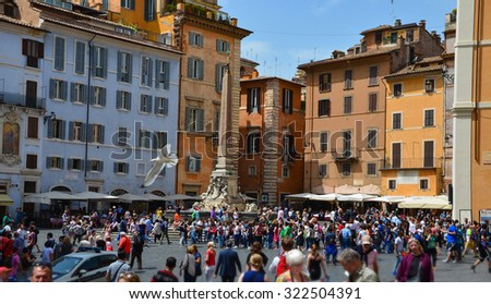 ROME - ITALY, MAY 6 2015: Tourists visit the Piazza della Rotonda near the Pantheon in Rome, Italy