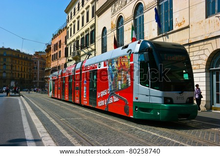 ROME, ITALY - MAY 22 : Tram picks up the passengers on the strreet of Rome on May 22, 2011. Public Transportion includes metro, buses and trams. - stock photo