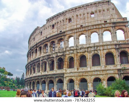 ROME, ITALY - NOVEMBER 09, 2003: Crowd of tourists visiting The  Colosseum of Rome, the largest amphitheater ever built.