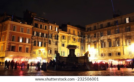 ROME, ITALY - NOVEMBER 8, 2014: evening  in Piazza di Santa Maria in Trastevere. Romans and tourists flock to Trastevere to enjoy its lively nightlife - stock photo