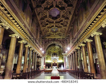 ROME, ITALY - NOVEMBER  30, 2013: people pray in the San Crisogono Basilica. This church was  built in the 4th century under Pope Silvester I (314-335) dedicated to the martyr Saint Chrysogonus.