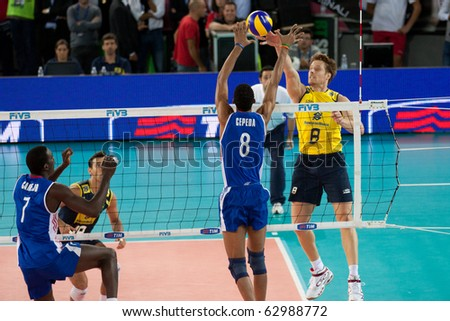 ROME, ITALY - OCTOBER 10: Cuba Rolando Cepeda Abreu stops ball at before Volleyball World Championships  final match Brazil vs Cuba at Palalottomatica in Rome on October 10, 2010