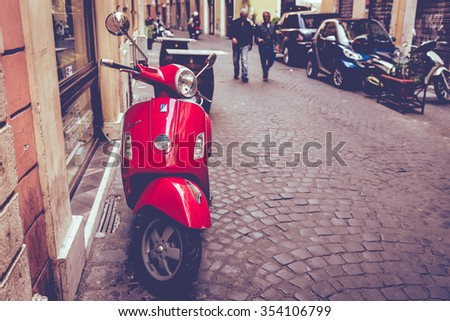Rome, Italy - October 20, 2014: Old red Vespa parked on old street in Rome, Italy. - stock photo