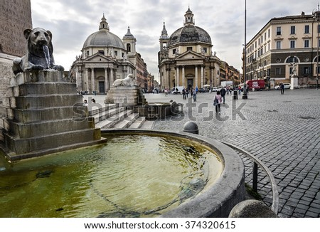 Rome, Italy - October 21, 2014: urban scene in Piazza del Popolo with the twin churches and lions fountain, is a large urban square in Rome - stock photo