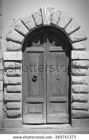 Rome, Italy. Old door, Italian architecture detail. Black and white tone - retro monochrome color style. - stock photo