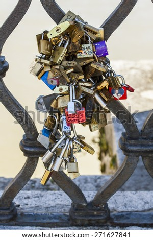 Rome, Italy, on March 6, 2015. traditional locks of lovers on a bridge protection