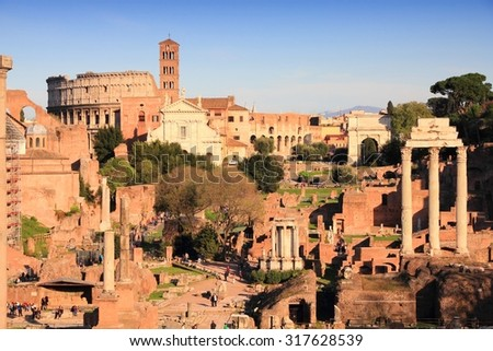 Rome, Italy - Roman Forum ruins and Colosseum in sunset light.