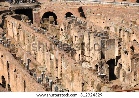 ROME, ITALY, SEP 13: People visiting inside of Colosseum in Rome, Italy and observe the ruins. The Colosseum is an elliptical amphitheatre in the centre of the city of Rome, Italy, SEP 13, 2009  - stock photo