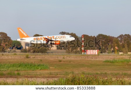 ROME, ITALY - SEPT 16: A EasyJet airplane lands at the airport in Rome, Italy on Sept. 16 2011.The airline operates domestic and international services and over 200 aircrafts mostly Airbus A319.