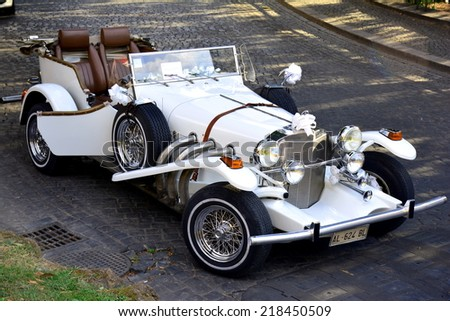 ROME, ITALY SEPTEMBER 6, 2014: A white vintage wedding car parked in Rome on September 6, 2014 in Rome.