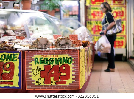 ROME, ITALY - 24 SEPTEMBER 2015: Price signs display the cost in euros of italian cheese on a stall inside an indoor market in Rome, Italy