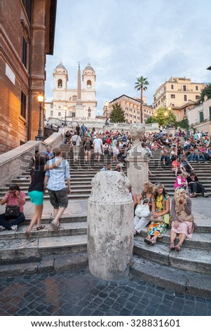 ROME, ITALY - SEPTEMBER 13, 2013: Spanish stairs on Piazza di Spagna in Rome on September 13, 2013. Spanish stairs is famous touristic destination in Rome. - stock photo