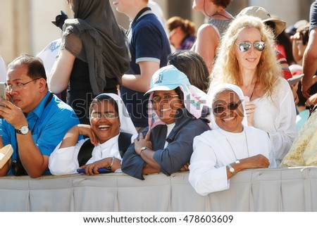 Rome, Italy - September 3, 2016: We are in Piazza San Pietro, during the celebrations of the holiness of Mother Teresa of Calcutta. Among the faithful that there are also some happy and smiling nun.