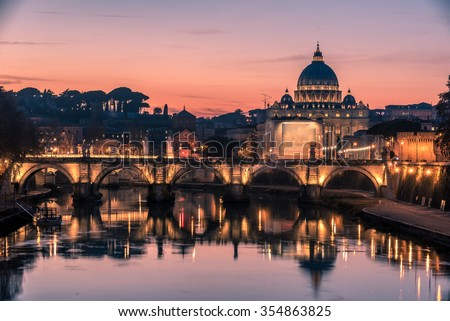 Rome, Italy: spectacular St. Peter's Basilica, Saint Angelo Bridge and Tiber River in the beautiful sunset of Mediterranean winter. Amazing picture representing the beauty of Italian capital city. - stock photo