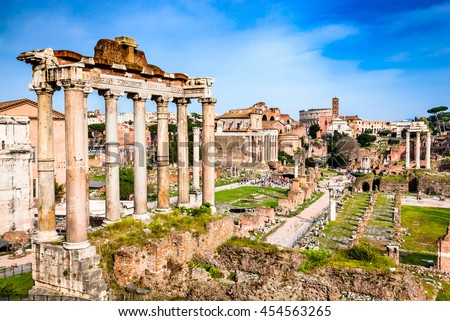 Rome, Italy.  Sunset view with ruins of Imperial Forum, Roman Empire. Background with Colosseum (Colosseo or Coliseum). - stock photo