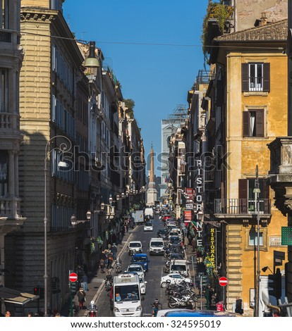 ROME, ITALY - 12TH MARCH 2015: A view down streets in Rome, showing building exteriors, traffic and people.