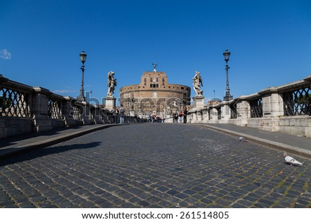 ROME, ITALY - 12TH MARCH 2015: Castel Sant'Angelo (Castle of the Holy Angel) from Ponte Sant'Angelo bridge. People can be seen near the building and on the bridge - stock photo