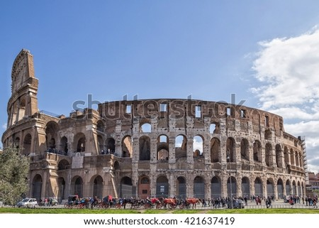ROME, ITALY; The Colosseum is most remarkable landmark of Rome and Italy. Colosseum is an elliptical amphitheatre in the centre of the city of Rome. - stock photo