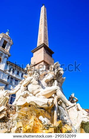 Rome, Italy. The famous Fountain of the Four Rivers with Egyptian obelisk in the middle of Piazza Navona in Roma, italian landmark. - stock photo