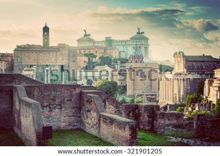 Rome, Italy vintage skyline. Roman Forum and Altare della Patria - National Monument to Victor Emmanuel II.  Deem, retro style light - stock photo