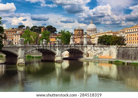 Rome. Italy. Vittorio Emanuele ii bridge on the Tiber river. In the background the dome of St Peter's Cathedral - stock photo