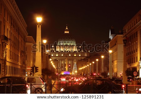 "ROME - JAN 6: traffic in front of  Saint Peter's Dome at night during ""adoration of the Magi"" celebration on  january 6, 2012 in Rome, Vatican City - stock photo"