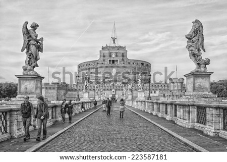 ROME - JANUARY 08: Castel Sant'Angelo on January 08, 2014 in Rome. The Mausoleum of Hadrian, usually known as the Castel Sant'Angelo, is a towering cylindrical building in Parco Adriano, Rome.  - stock photo