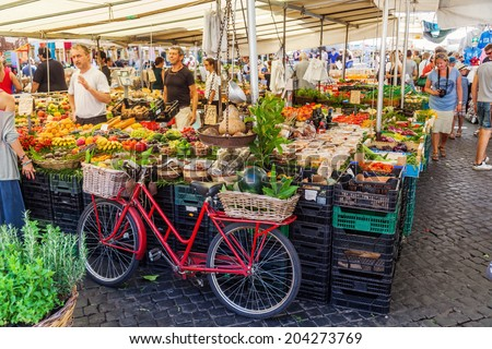 ROME - JULY 02: market on the square Campo de Fiori with unidentified people on July 02, 2014 in Rome. In the year 1600 the philosopher Giordano Bruno was executed as a heretic on this famous square - stock photo