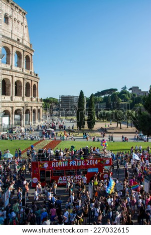 ROME - JUNE 7: Rome Gay Pride Parade on June 7, 2014 in Rome, Italy. The passage of the parade under the Colosseum - stock photo