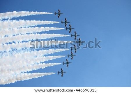 ROME - JUNE 28: The italian acrobatic team Frecce Tricolori perform at the Rome International Air Show on June 28, 2014 in Rome, Italy - stock photo