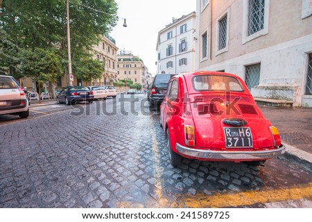 ROME - JUNE 14: Vintage red Fiat 500 parked in Via della Cosulta on June 14, 2014 in Rome, Italy. The world famous Italian automobile brand founded in 1899 - stock photo