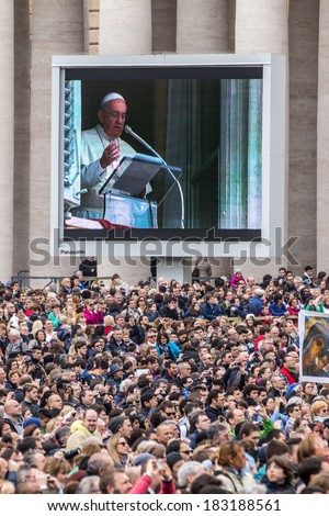 Rome, 23 March 2014: the Faithful in St. Peter's Square to hear the Angelus of Pope Francis. Pope Francis to the big screen. March 23, 2014, Vatican City, Italy - stock photo