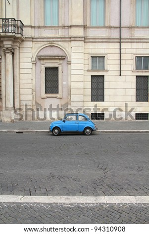 ROME - MAY 12: Fiat 500 parked on May 12, 2010 in Rome, Italy. With almost 4 million units sold, Fiat 500 is among Top 50 cars in automotive history. Nowadays it is desired by collectors. - stock photo
