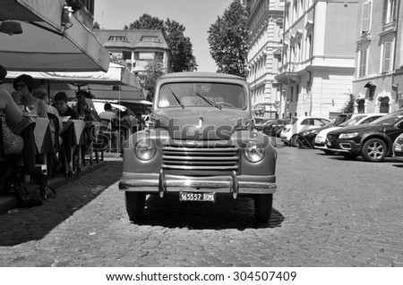 ROME - MAY 09: Old Fiat at Trastevere in Rome on May 09. 2015 in Italy - Fiat S.p.A., or Fabbrica Italiana Automobili Torino was an Italian holding company. Black and white photo