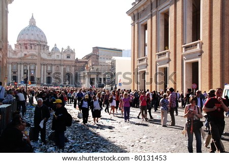 ROME - MAY 1 : pilgrims walk in st Peter's square during the beatification of Pope John Paul II on may 1, 2011 in Rome - stock photo