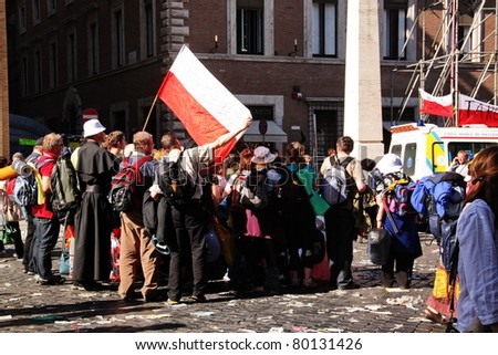 ROME - MAY 1 : polish pilgrims take a group photo during the beatification of Pope John Paul II on may 1, 2011 in Rome - stock photo