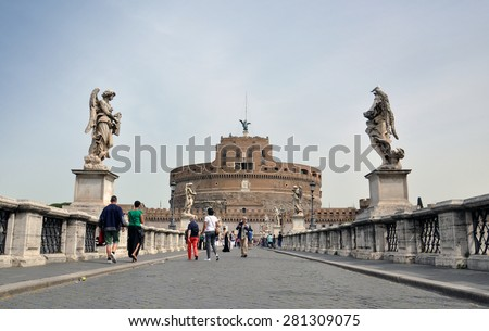 ROME - MAY 06: St. Angelo Bridge and St. Angelo Castle in Rome on May 06. 2015 in Italy - The bridge St. Angelo is decorated with ten angels holding instruments of the Passion of Bernini's project. - stock photo