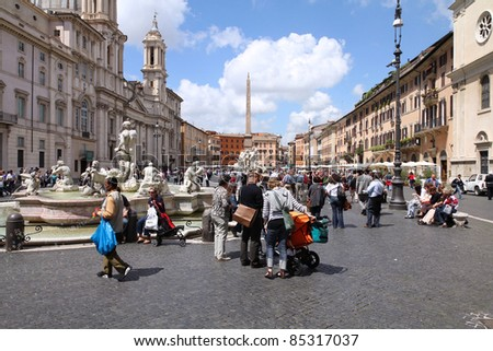 ROME - MAY 13: Tourists at Piazza Navona on May 13, 2010 in Rome, Italy. Piazza Navona is a popular destination in Rome, the 3rd most visited city in European Union. - stock photo