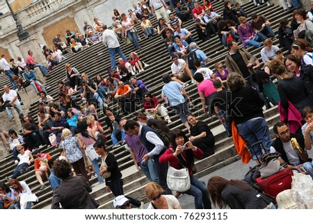 ROME - MAY 12: Tourists rest on May 12, 2010 in Rome, Italy. Piazza di Spagna with its fountain and Spanish Steps is among most iconic squares worldwide and one of Italy's top tourism destinations - stock photo