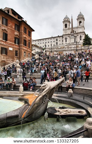 ROME - MAY 12: Tourists stroll on May 12, 2010 in Rome, Italy. Piazza di Spagna with Spanish Steps is one of the most iconic city squares in the world and one of Italy's top tourism destinations. - stock photo