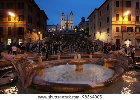 ROME - MAY 10: Tourists strolling on May 10, 2010 in Rome, Italy. Piazza di Spagna with its fountain is one of the most iconic city squares in the world and one of Italy's top tourism destinations. - stock photo