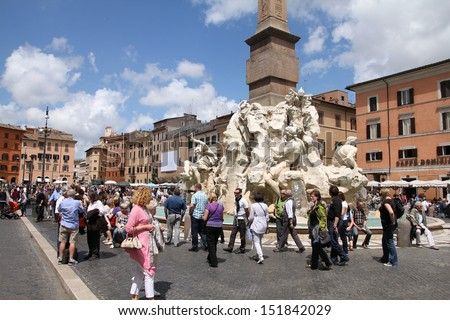ROME - MAY 13: Tourists visit Piazza Navona on May 13, 2010 in Rome, Italy. The iconic square is one of the most visited landmarks in the world and a top tourism destination in Italy. - stock photo