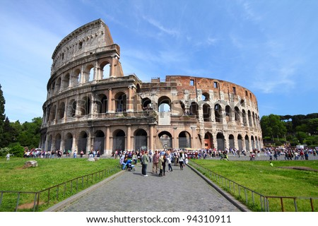 ROME - MAY 9: Tourists visit the Colosseum on May 9, 2010 in Rome, Italy. According to Euromonitor's Destination Ranking, Rome is the 3rd most visited city in Europe (5.5m int'l tourist arrivals 2009)